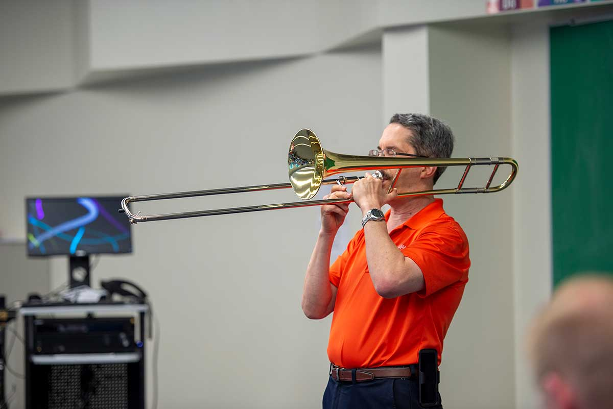 Tony Garcia demonstrating trombone techniques during his clinic.