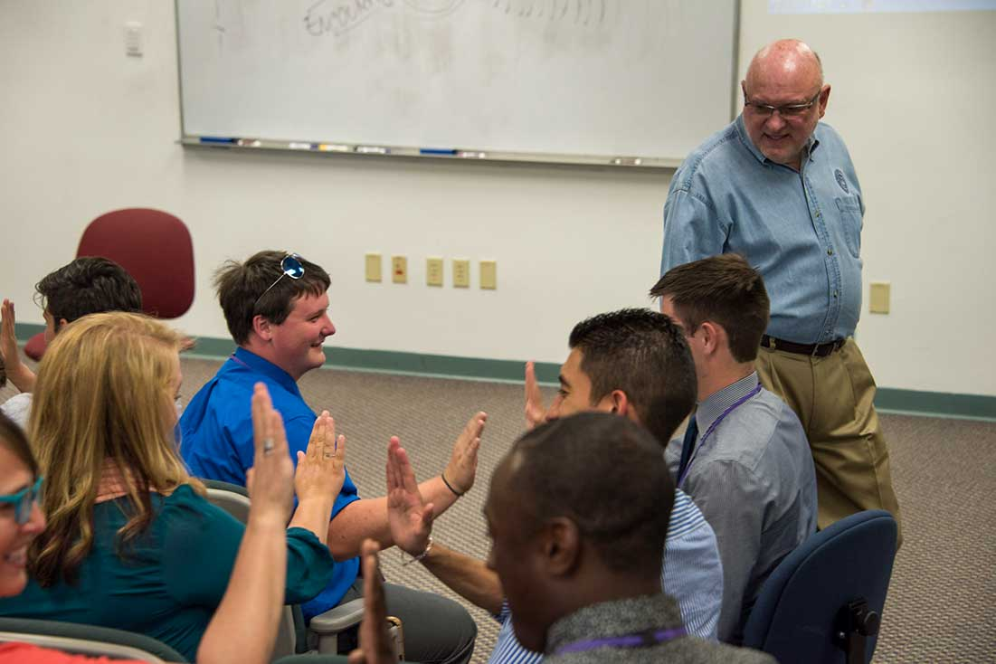 Tim Lautzenheiser conducting a group activity at the Conn-Selmer Institute.